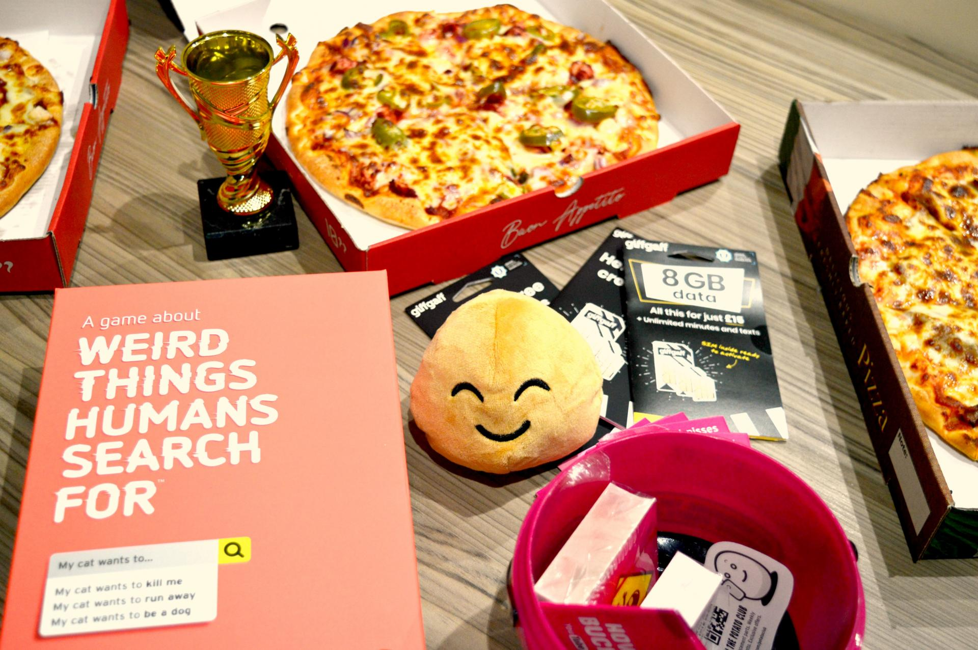 This is an image featuring pizza, a trophy, sim cards and board games along with a cute plush potato which were all very kindly gifted to me as part of the #GiffGaffGamers campaign.